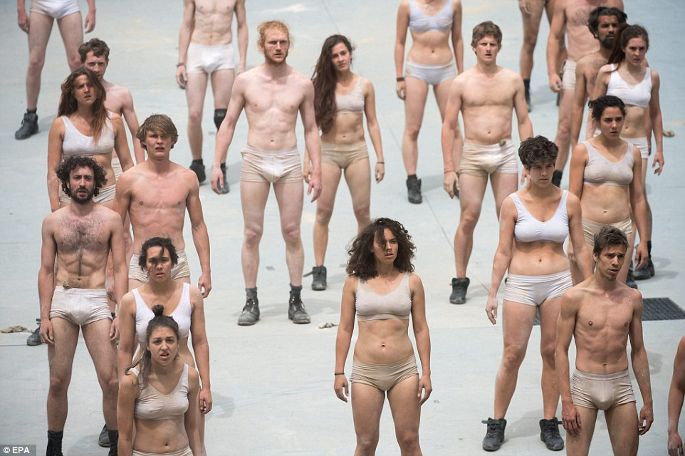 Happy to be involved: A dance troupe performed during the ceremony in just their underwear. The entire out-there piece was orchestrated by German director Volker Hesse