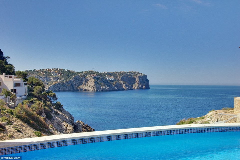 Breathtaking blues: The pool overlooks the ocean and the staggering views of the island's clifftops