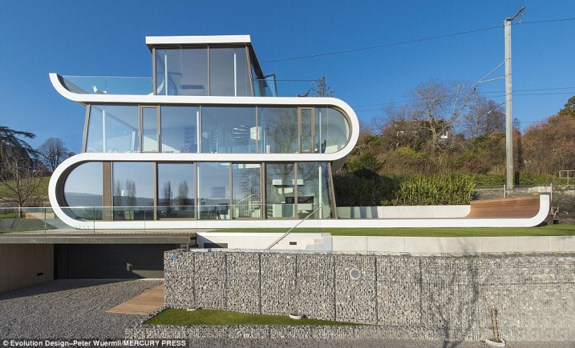Futuristic: The ribbon-shaped Flexhouse boasts striking views of Lake Zurich, Switzerland, from its two roof terraces