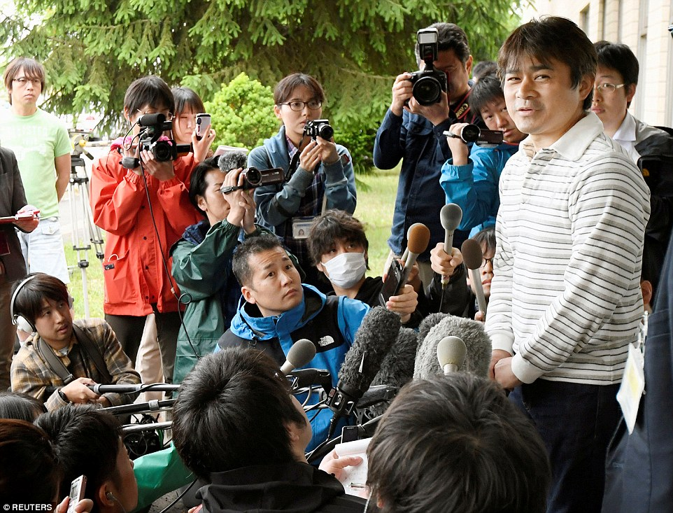 Takayuki Tanooka addressed the media on the day his son was found alive after six days in a forest