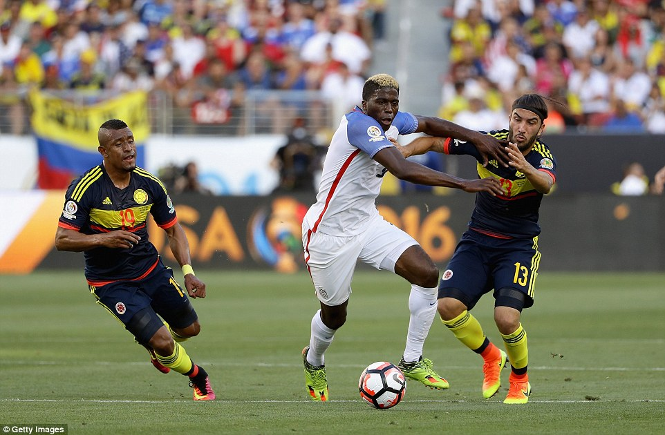 Sebastian Perez of Colombia (right) controls the ball in front of Geoff Cameron of the USA as the pair battle for possession