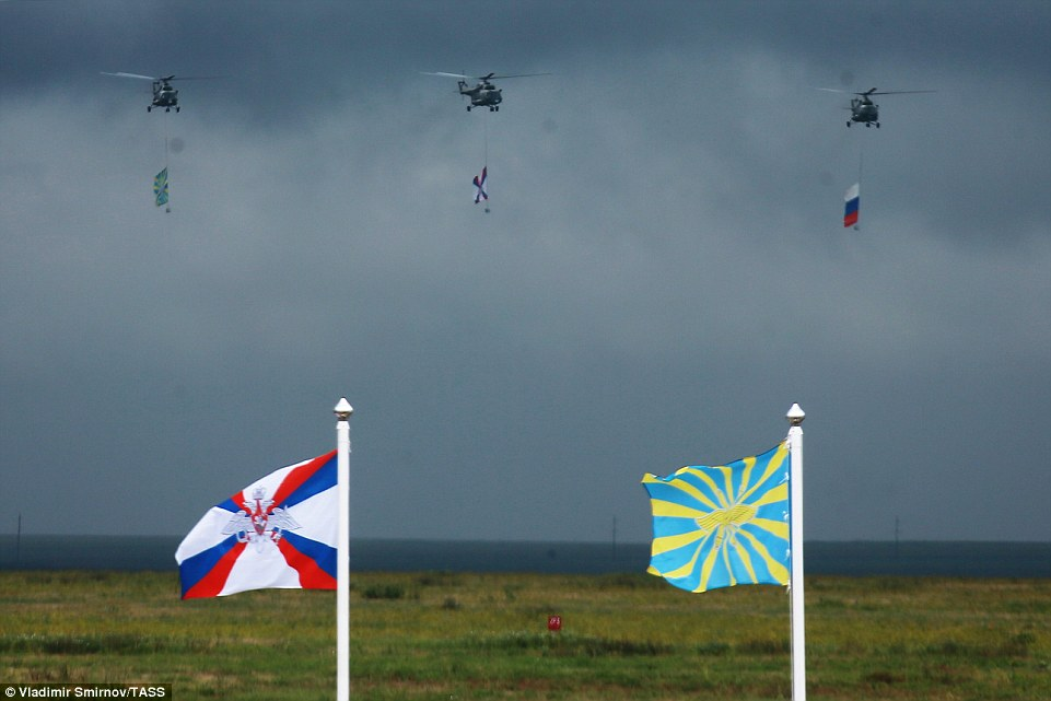 Proving to be a display in patriotism, threeMil Mi 8 helicopters carried the national Russian flag and the Russian air force flag