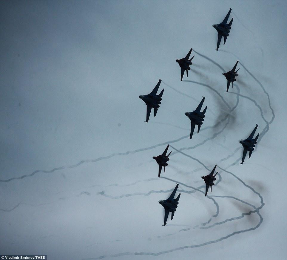 Nine Sukhoi Su 27 fighter jets from the Russkiye Vityazi [Russian knights] aerobatic team tore through the skies