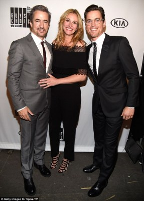 Impressive: She shot to fame after starring in the romantic comedy Pretty Woman in 1990 and went on to win an Academy Award for Best Actress award for the 2001 flick Erin Brockovich. -Pictured withDermot Mulroney (L) and Matt Bomer (R)