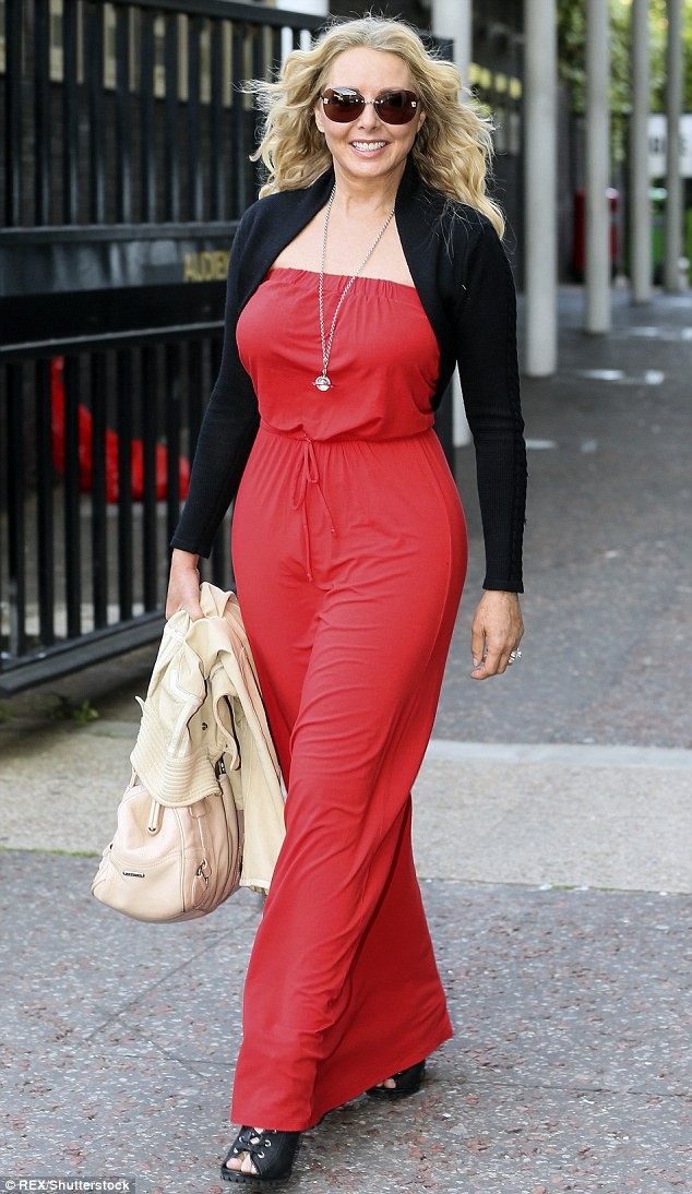 Carol Vorderman subtly shows off famous derriere in fitted