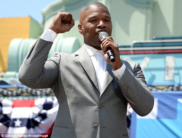 Taking the stage: Jamie Foxx appeared at the Hillary Clinton rally on Monday in Los Angeles