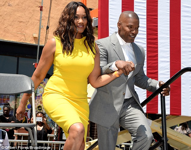 What a gentleman: The movie star escorted Garcelle, 49, to the stage