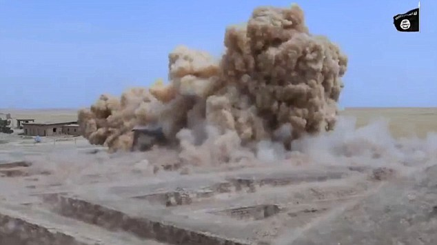 ISIS extremists have threatened to destroy the Egyptian pyramids - after releasing a video purporting to show fighters blowing up a 2,500-year-old temple in Iraq (pictured)