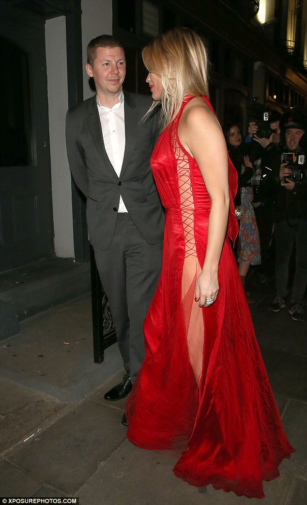 Who could blame him? Professor Green looked a little flirty as he chatted to the stunner, who wore a red dress which had a semi-sheer panel running down the sides