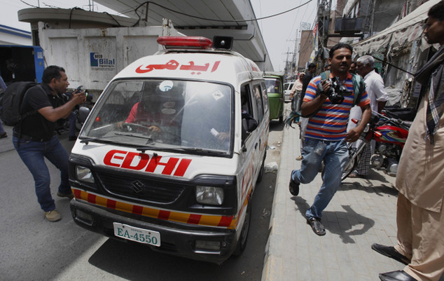 The ambulance transporting the body of Zeenat Rafiq drives to the morgue of a local hospital in Lahore