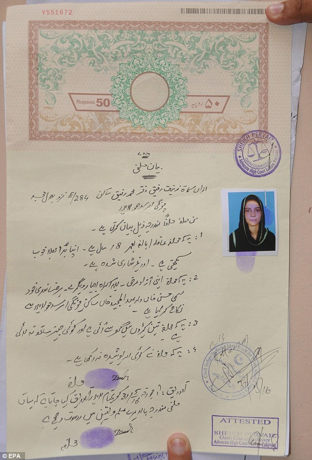 The marriage certificate that was to lead to a death: Hassan Khan, husband of Zeenat Rafiq who was burnt alive by Zeena'ts mother, shows their marriage certificate in Lahore, Pakistan