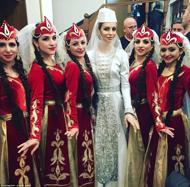 The bride changed into traditional dress to perform with Georgian dancers. It was one of three gowns she wore at the elaborate celebration