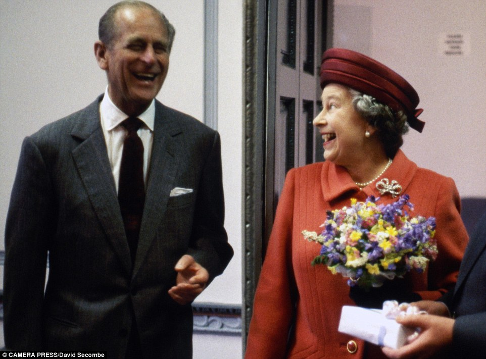 Secret to their relationship: Prince Philip and the Queen are captured in an informal picture taken during a visit to Cumbria in 1991