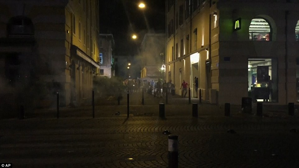 Deterrent: Police used tear gas to disperse the angry crowds after trouble flared with England fans in Marseille