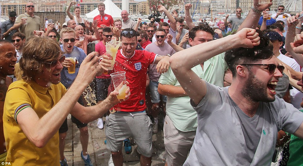 England fans spill their beers as they chant in the Old Town ahead of the match against Russia tomorrow night
