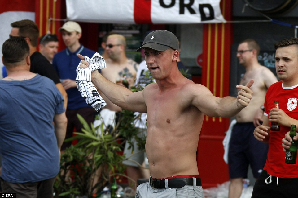 An English fan goads Russian hooligans as violence explodes onto the streets of Marseille's Old Port district for the second night in a row