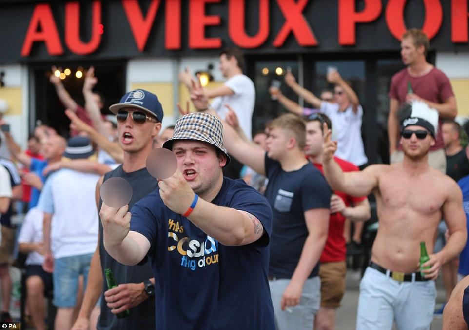 Drunken English football fans taunt French supporters in the Old Port area of Marseille ahead of the England's opening match in Euro 2016