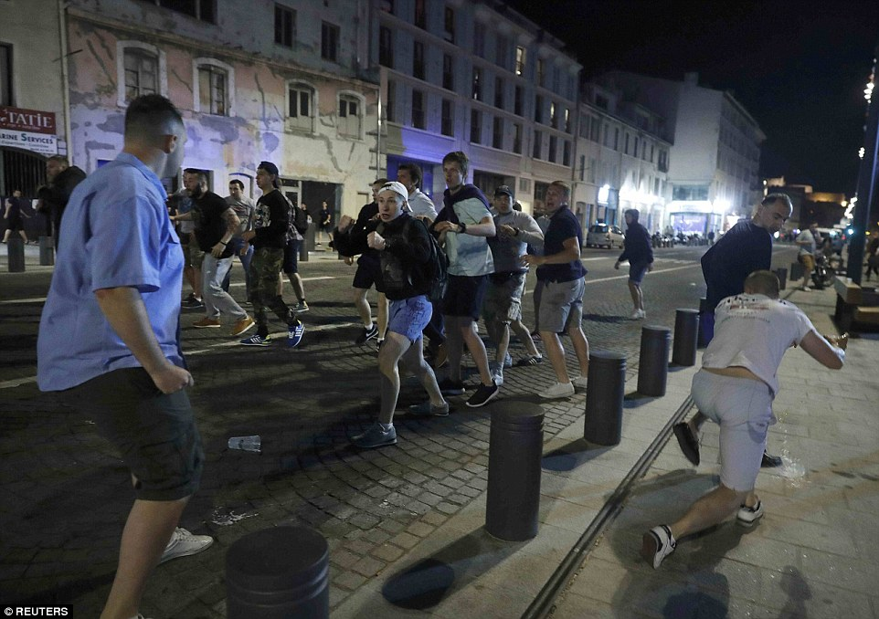 Local youths confront supporters on the streets of Marseille's Old Port district as fans continue with violence that broke out this afternoon