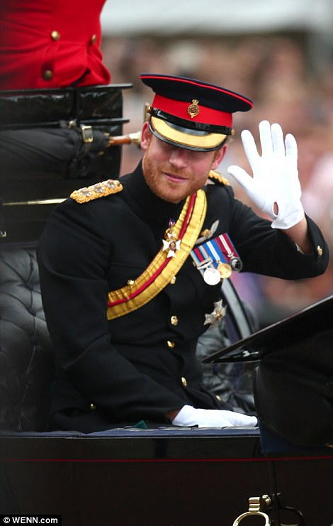 Prince Harry waves to crowds