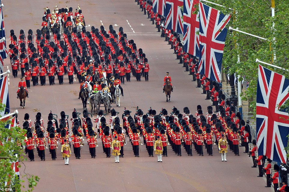 Marching: A procession of the Household Division moved down The Mall back to Buckingham Palace after the ceremony
