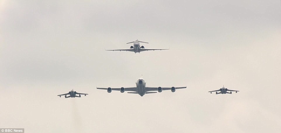 Formation: A Sentinel R1 reconaissance plane, top, leads two Typhoon fighters, left and right, and an RC-135W Rivet Joint spy jet on the fly-past