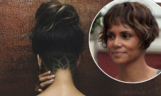 halle berry debuts new hairstyle with lotus design on
