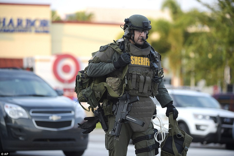 Fatalities: At least 50 people were killed and 53 others were injured in the shooting. Pictured: An Orange County Sheriff's Department SWAT member