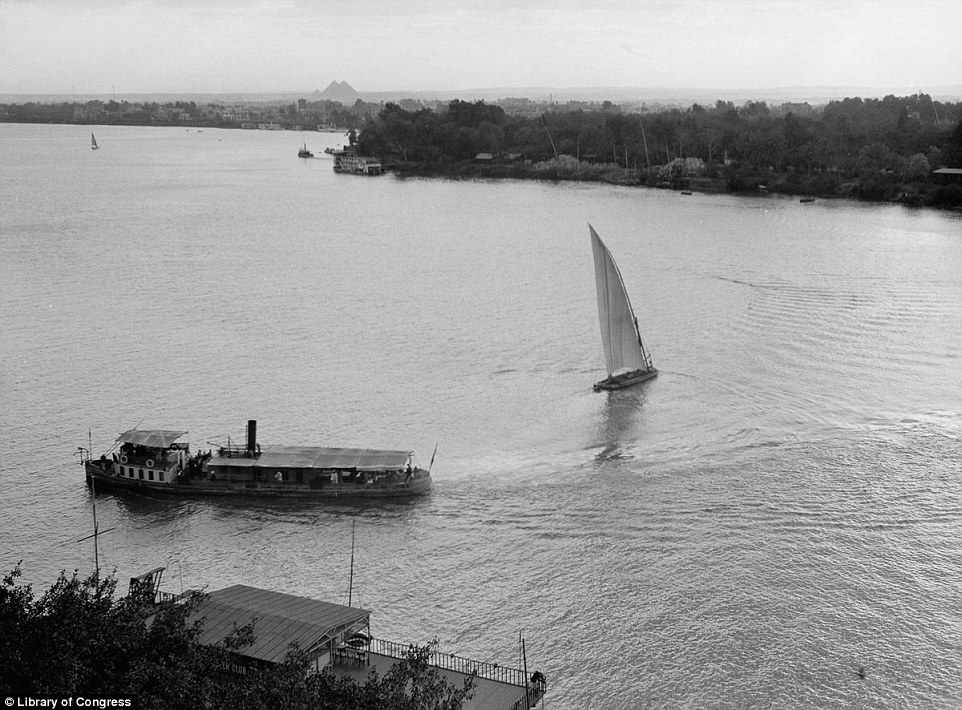 Times are changing: A felucca sails past a steamboat on the Nile in this image from 1920 which juxtaposes the old and new world