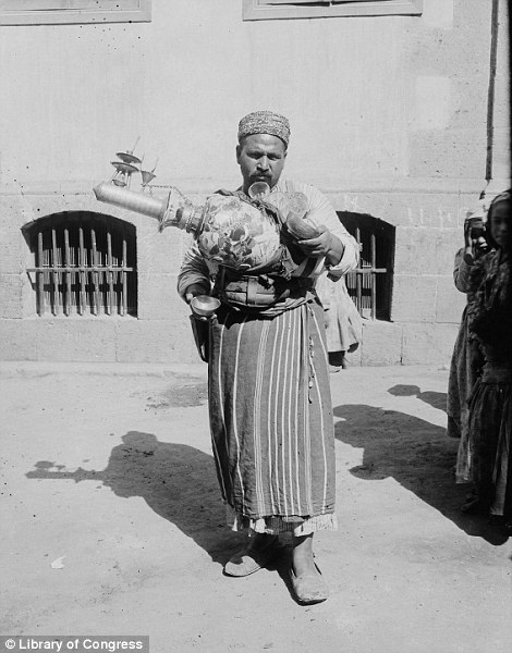 This man, pictured in 1900 carrying an unusual contraption, is a lemonade vendor
