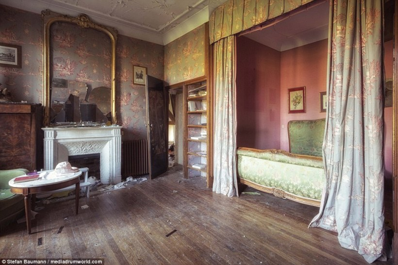 One of the master bedrooms in an abandoned chateau in France. With the hat and book so positioned it almost seems as though the occupants fled in a hurry - although with a bed like that why would you?