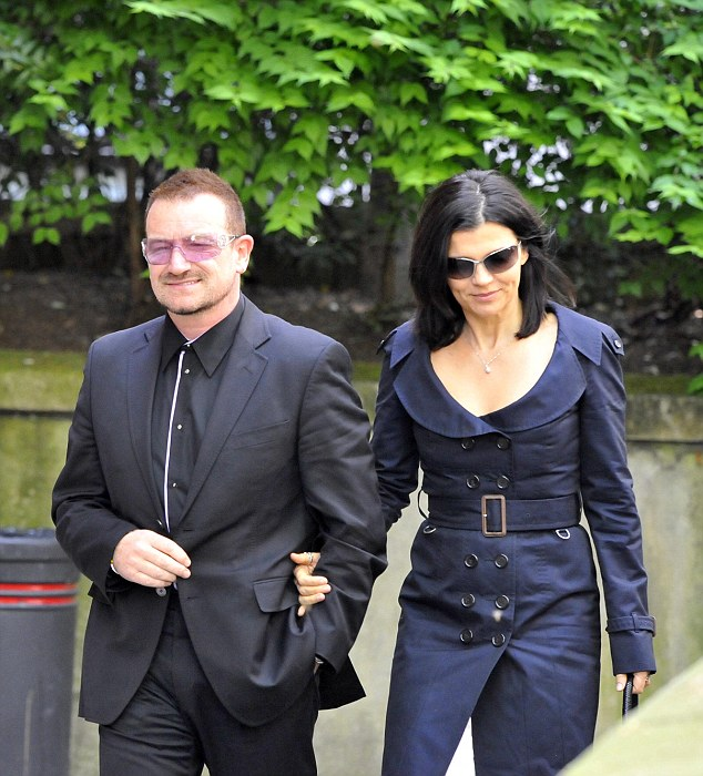 International stars including Bono and his wife Ali Hewson, pictured right, attended his funeral in 2009
