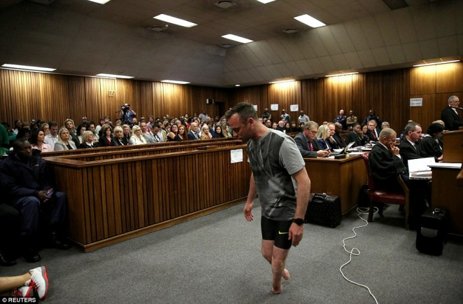 Pathetic: Oscar Pistorius teeters on his stumps in front of a packed court roomafter taking off his prosthetic limbs in a desperate plea for leniency in a hearing that will determine his sentence for murdering his girlfriend Reeva Steenkamp