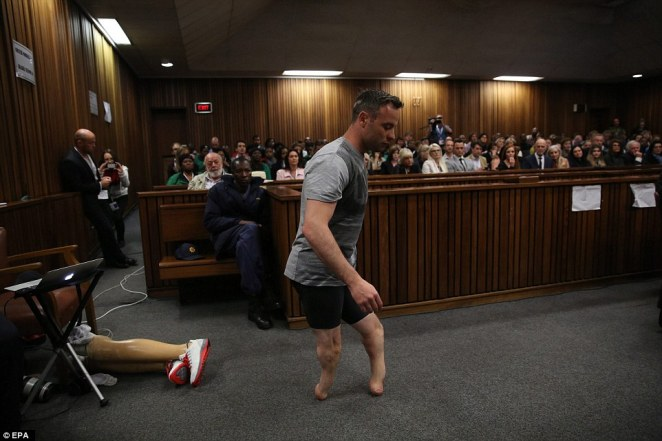 Humiliated: Paralympic gold medalist Oscar Pistorius walks across the packed courtroom on his stumps in a desperate last bid to convince a judge he was too vulnerable to have killed his girlfriend Reeva Steenkamp intentionally when he shot her at his home three years ago
