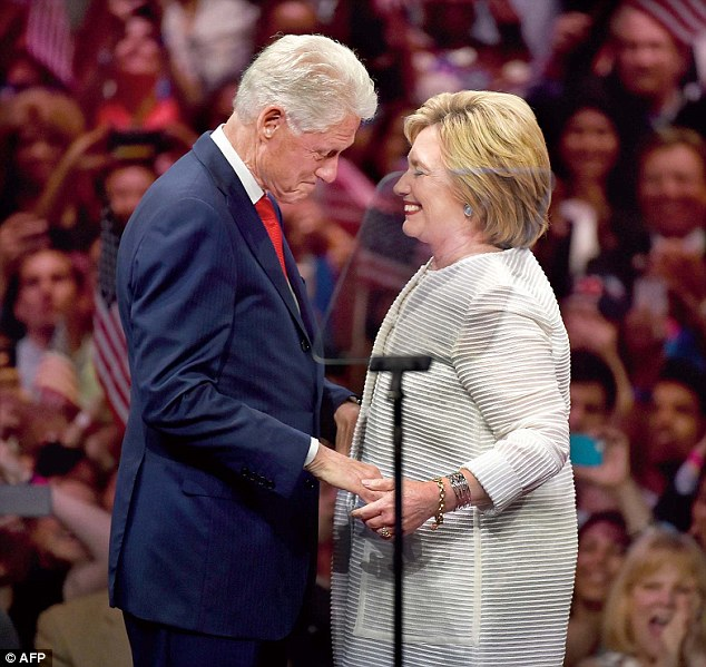 Dolly saysHillary (pictured with Bill on Tuesday) was caught on record blurting out the terms 'stupid k**e' and 'f***ing Jew bastard', while Bill called the Reverend Jesse Jackson a 'G**damned n****r'