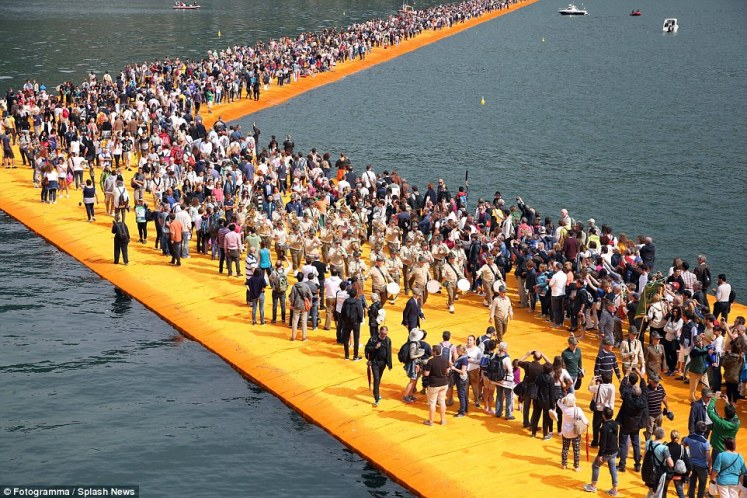 Visitors can walk from Sulzano to Monte Isola and onto the island of San Paolo, which is framed by The Floating Piers