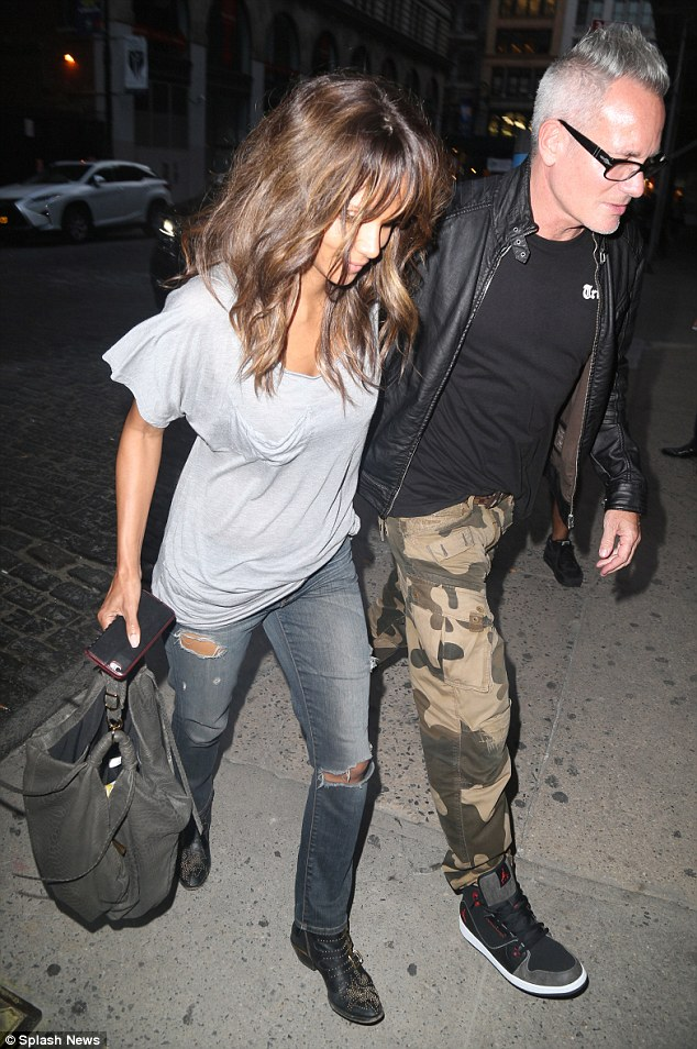 Halle Berry Cuddles Up To Photographer Cliff Watts While