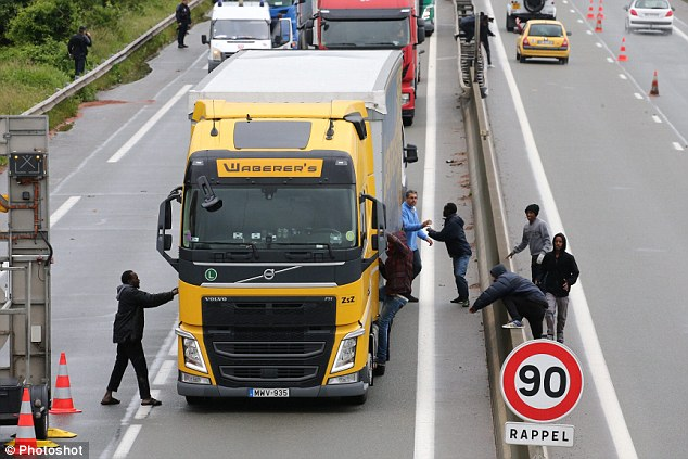Witnesses said that migrants blocked traffic on the way to the port so they could break into lorries in a desperate bid to reach Britain