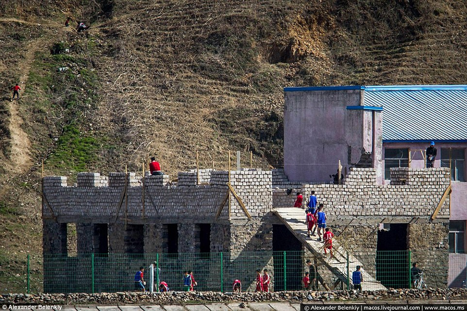 Teaching: These schoolchildren were observed helping to build a block during a physical education lesson in a chilling sign of how everyone in North Korea must work