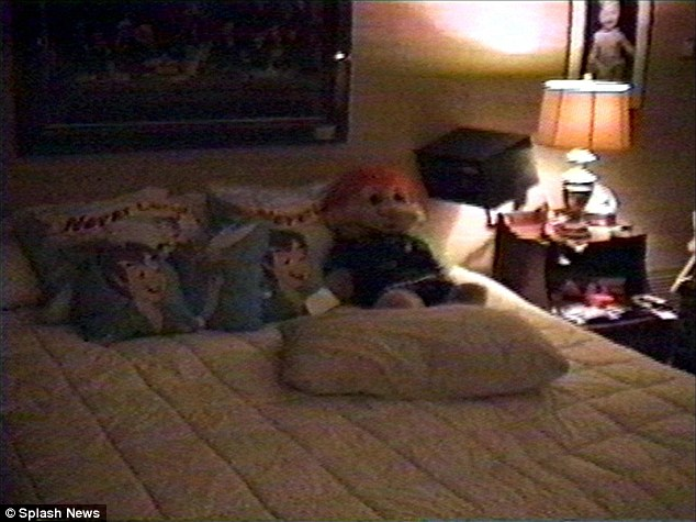 Place to sleep: A bed with Peter Pan pillows and a troll doll in the secret closet (above)