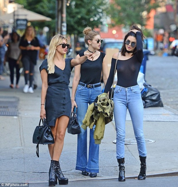 Breast friends: Kendall Jenner did the impossible on Tuesday - ensured all eyes were on her despite being flanked by model friends Hailey Baldwin and Gigi Hadid in New York