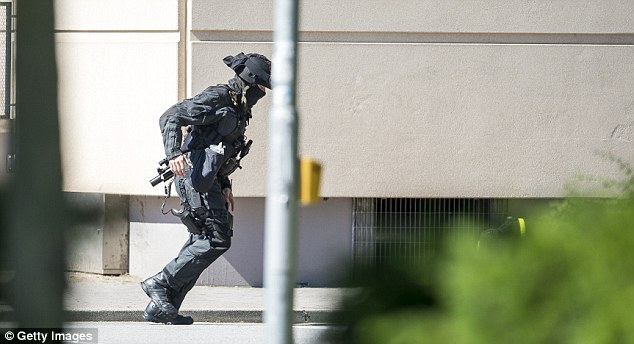 According to initial media reports, the man entered the cinema today at approximately 3pm, fired a shot in the air and barricaded himself inside