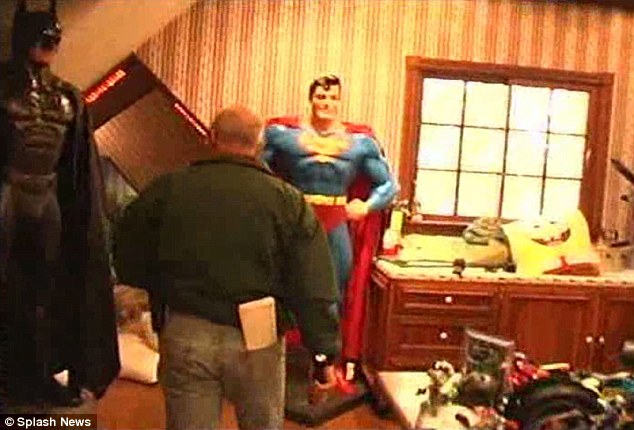 Chilling: The pornography had been stored in hidden rooms with secret entrances, just along corridors from bedrooms and playrooms filled with toys and life-sized statues of superheroes (pictured)
