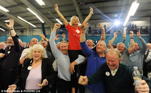 Vote Leave supporters celebrate as a landslide victory in Sunderland points to final result - a win for Brexit