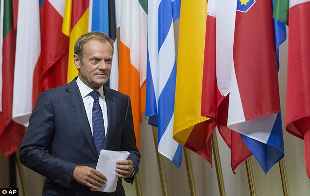 European Council President Donald Tusk prepares to address a media conference at the EU Council building in Brussels today
