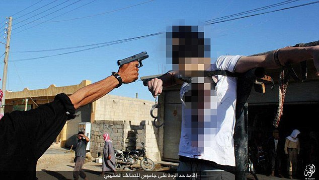 The man, identified as Mohammed Al Kadri, was strapped to a metal pole and had a gun pointed to his head