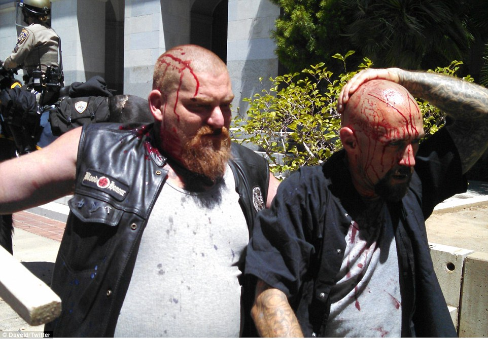 At least seven people have been rushed to the hospital, some in critical condition, after clashes between members of a neo-Nazi political party and counter-demonstrators in Sacramento (pictured, injured neo-Nazis)