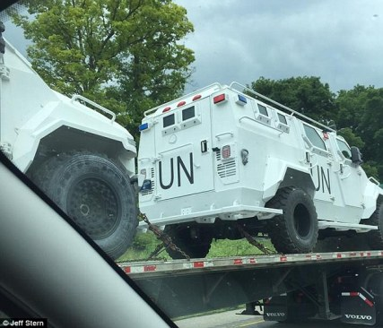 The white trucks, equipped with large off-road tyres, were seen being transported on Interstate 81 on Friday