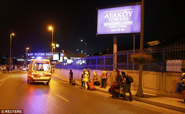 Holidaymakers drag their suitcases outside the airport, as all flights were grounded following the attack