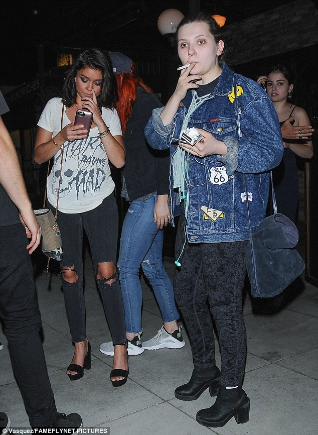 Out on the town: Abigail Breslin was seen puffing on a cigarette as she and co-star Sarah Hyland hit a bar in Studio City, California on Thursday evening