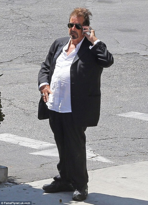 Al Pacino (pictured) appeared to have piled on the pounds and looked virtually unrecognisable while on the phone outside the Macha Theatre
